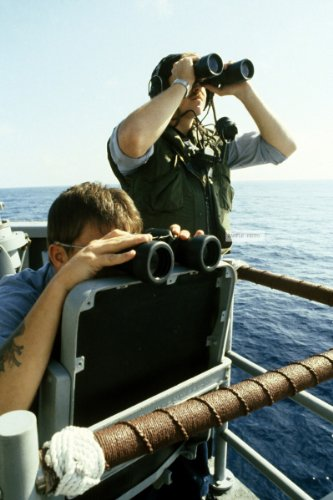Photo Navy Seamen Use Binoculars To Spot Simulated Hostile Aircraft From The Deck Of A Frigate During Exercise Cope Thunder '84, 02/16/1984