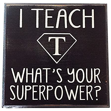 """This beautiful and intricate handmade """"I Teach, What's Your Superpower?"""" Rustic Wood Sign is made from Cedar Wood milled in the USA. This wall decor or classroom decor 'Sit or Hang Wood Block Sign' has the finest details and highest quality craftsman..."""