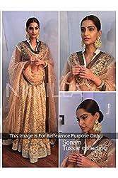 Designer CREAM NET Bollywood Replica Lehenga Choli.