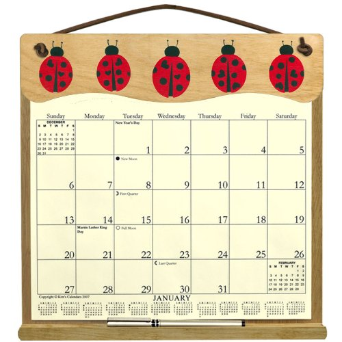 Wooden Refillable Wall Calendar Holder filled with a 2017 calendar and an order form for 2018-LADYBUGS