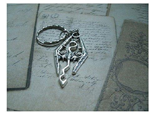 portachiavi-o-collana-o-orecchino-che-rappresenta-un-drago-in-metallo-argentato-skyrim-morrowind-obl