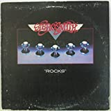 Aerosmith Vinyl Record Collection w/ Rocks (1976), Draw the Line (1977), Live Bootleg (1978), Done with Mirrors (1984), and Permanent Vacation (1987)