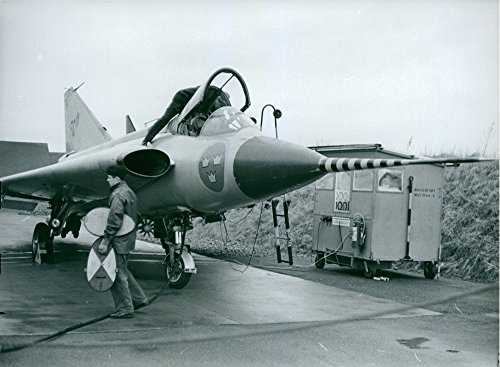 vintage-photo-of-an-air-force-man-in-front-of-a-fighter-plane-at-the-air-force-test-centre-fc-in-mal