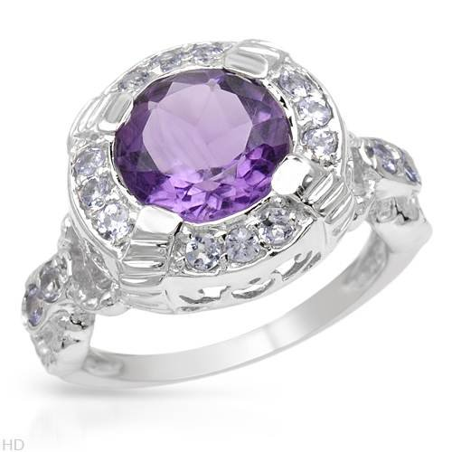 Sterling Silver 3.3 CTW Amethyst and 0.48 CTW Tanzanite Ladies Ring. Ring Size 7. Total Item weight 5.9 g.
