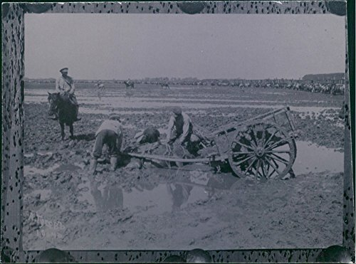 vintage-photo-of-world-war-i-1914-18soldiers-patrolling-in-the-field-while-the-farmers-trying-to-get