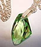 Dramatic, abstract peridot green rhinestone pendant and necklace with Swarovski rhinestone