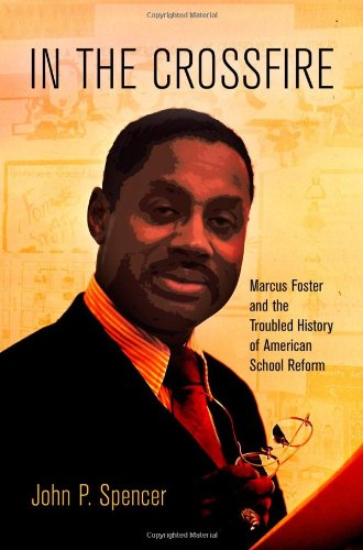 In The Crossfire: Marcus Foster And The Troubled History Of American School Reform (Politics And Culture In Modern America) front-429167