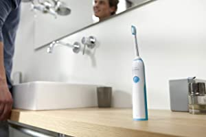 Philps Sonicare Essence+ Rechargeable Electric Toothbrush, Gentle Yet Effective, Brown Box Packaging, Mid-Blue (Color: White & Navy Blue)