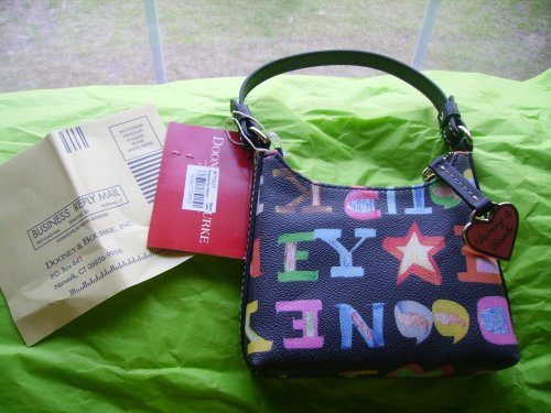 Dooney & Bourk New bitsy bag with registration card!