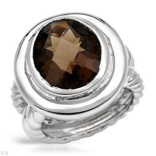 Ring With 5.60ctw Genuine Topaz Made in 925 Sterling silver. Total item weight 12.5g (Size 6)