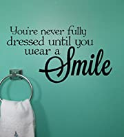 Wall Decor Plus More WDPM3183 Never Dressed Wear a Smile Wall Decal Inspirational Quote 23x12.5 Inch Black from Wall Decor Plus More
