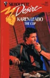 img - for The Cop (Silhouette Desire) book / textbook / text book