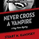 Never Cross a Vampire Audiobook by Stuart Kaminsky Narrated by Brian Holsopple
