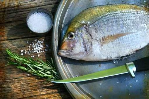 Freshly Caught Fish on Cooking Platter with Sea Salt and Herbs - 60