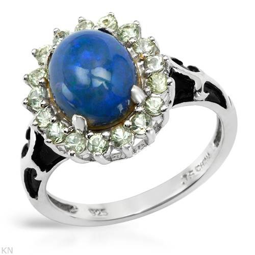 Sterling Silver Opal and 0.65 CTW Sapphire Ladies Ring. Ring Size 7. Total Item weight 4.0 g.