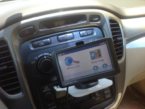 """Universal """"The Insertable Gps Mounting Pad"""", (Choice Of Cd Player Version Or Cassette Player Version). Suction Cup Is Mounted On The Pad Allows Gps And Other Portable Devices To Be Mounted Below Dash Level."""