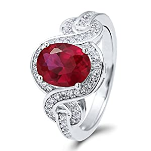 BERRICLE Sterling Silver Oval Cut Simulated Ruby Cubic Zirconia CZ Solitaire Woven Womens Ring from BERRICLE