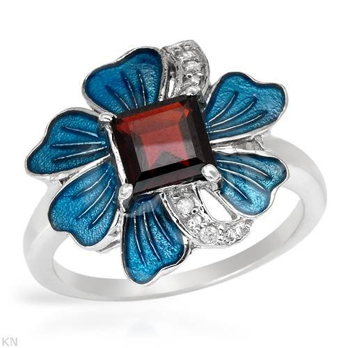 Sterling Silver 1.25 CTW Garnet and 0.08 CTW Cubic Zirconia Ladies Ring. Ring Size 7. Total Item weight 4.0 g.
