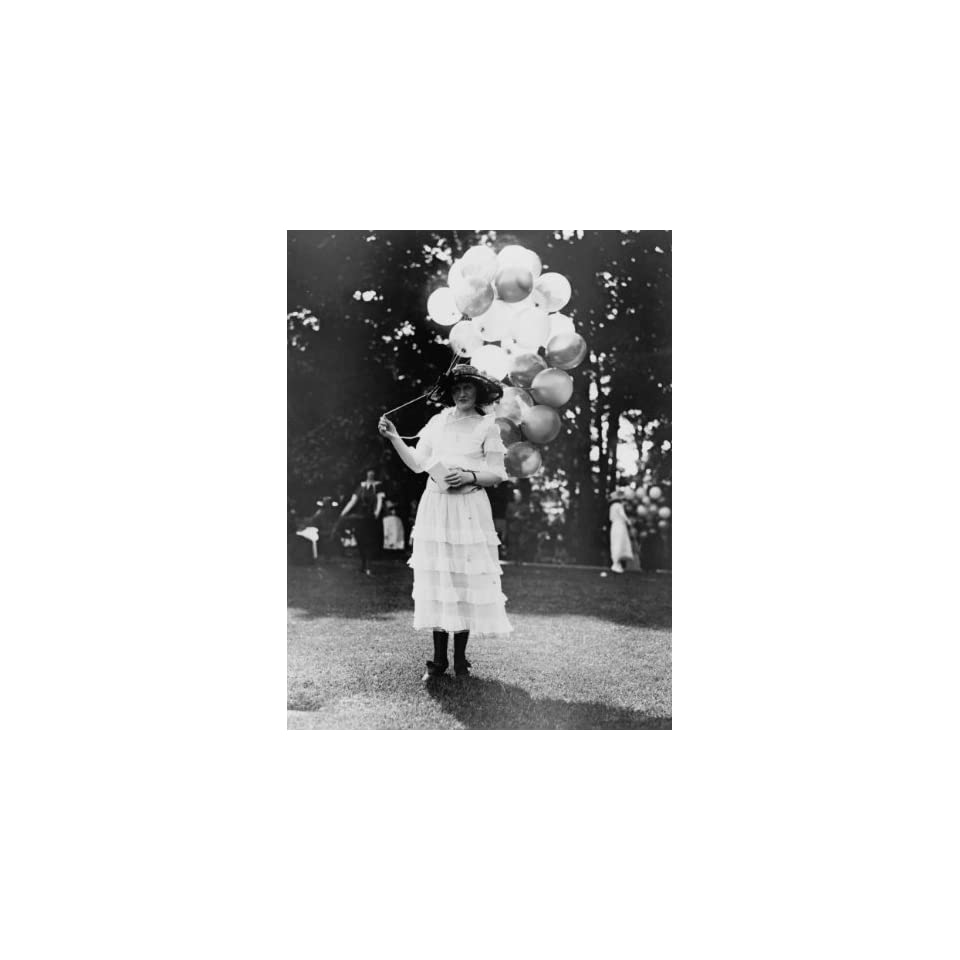 1920s photo Mrs. Orme Thornberry, balloon girl at the Near East Relief Benefit Garden Fete Woman holding balloons. Vintage Black & White Photograph