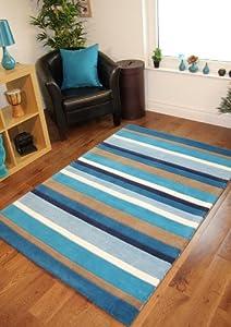 Tapis pour salon bleu blanc et beige motif ray 100 laine for Tapis decoratif pour salon