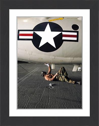 framed-print-of-airman-cleans-the-underside-of-an-e-2c-hawkeye