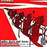 And Horns by Miles Davis (1999-07-08)