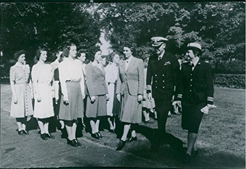 vintage-photo-of-colonel-mildred-mcafee-with-the-other-officers-walking-while-group-of-women-standin