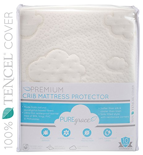 PUREgrace Crib Mattress Pad - Superior To Organic Cotton - All Natural TENCEL (Eucalyptus Based Pure Fibers) - Soft and Breathable Waterproof Protector - Premium Quality and Hypoallergenic - Safe Fitted Comfortable Mattress Cover - 10 Year Warranty