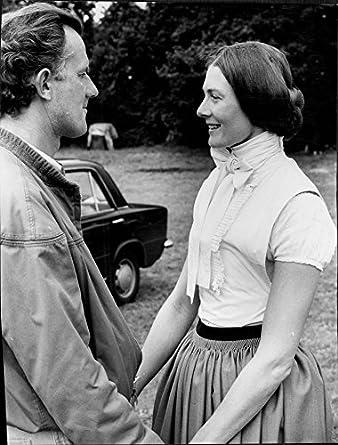 Vintage photo of Vanessa Redgrave standing with Tony Richardson,holding