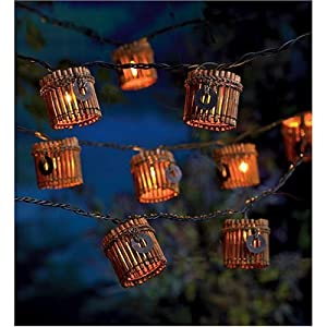 bamboo tiki string lights with charms dark wood kitchen
