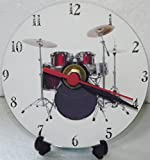 A RED DRUM KIT WITH GREY BASS DRUM DESIGN PRINTED ON A CDDVD 12 cm diameter SIZED NOVELTY CD QUARTZ WALLDESK CLOCK WITH FREE BATTERY AND DESK STAND CAN BE PERSONALISED FOC