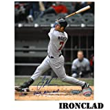 Joe Mauer Autographed 8x10 Vertical Swinging from 3rd Base Side w/