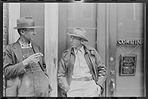 Two farmers talking in front of a bank in Roxboro,North Carolina