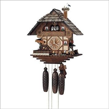 Orologio a cucù Casa del taglia legno con fabbro in movimento e la ...