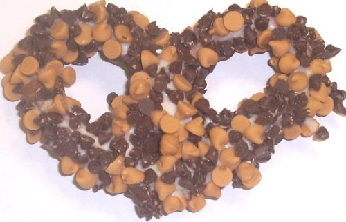 Scott's Cakes 1 lb. White Chocolate Covered Pretzels with Chocolate Chips & Peanut Butter Chips in a Small Fruit Tin