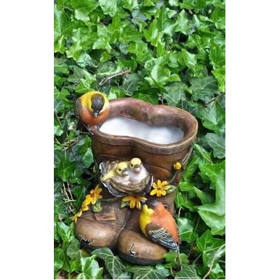 Brown welly boot with bird planters