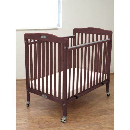Folding Wooden Compact Crib In Cherry front-829369