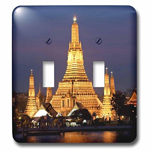 danita-delimont-temples-wat-arun-at-dusk-with-boat-on-chao-phraya-river-bangkok-thailand-light-switc