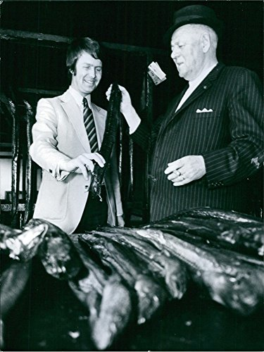 vintage-photo-of-two-men-checking-fish-from-bunch-henning-w-nilssonalex-port