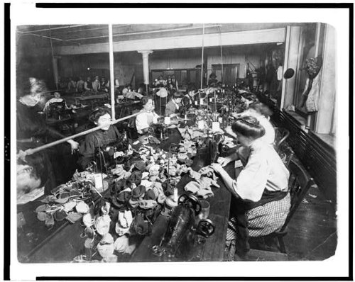 People making teddy bears in factory