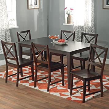 7 Piece Dining Table and Chair Set in Espresso Finish. Update Your Dining Space with the Elegant Cross-back Espresso Dining Set. With a Large Shaker Style Table and Six Cross-back Chairs in a Rich Espresso Finish to Complement Any Decor.
