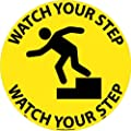"NMC WFS1 Walk On Floor Sign with Graphic, ""WATCH YOUR STEP"", 17"" Diameter, Pressure Sensitive Vinyl, Black On Yellow"