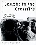 img - for Caught in the Crossfire: Growing Up in a War Zone book / textbook / text book