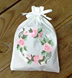 Cotton Hand-Embroidered Drawstring Lavender Bags (sold with lavender filling) Beautiful handmade white cotton drawstring lavender bag with Rose & Daisy Wreath Embroidered Pattern. Use as a pretty scented gift, sleep pillow, drawer scenter, linen cupboard