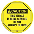"Accuform Signs KDD738 STOPOUT Vinyl Steering Wheel Message Cover, ANSI-Style Legend ""CAUTION THIS VEHICLE IS BEING SERVICED DO NOT ATTEMPT TO DRIVE"", 24"" Diameter, Black on Yellow"