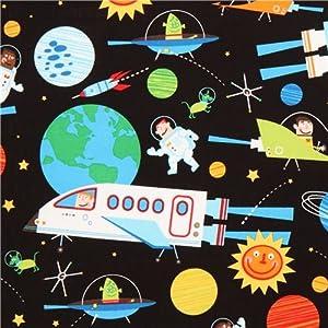 Tissu Robert Kaufman noir avec la galaxie et une navette
