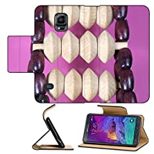 buy Luxlady Premium Samsung Galaxy Note 4 Flip Pu Leather Wallet Case Wooden Roller Massager On A Pink Background Image Id 26272225