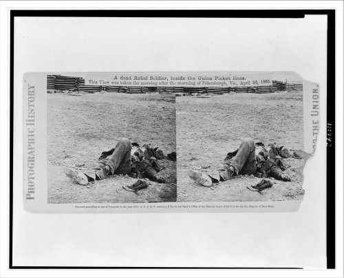 Stereoview (L): A dead Rebel soldier inside the Union picket lines. This view was taken the morning
