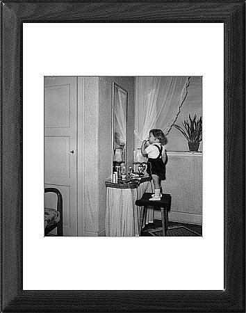 Framed Print of Girl doing makeup from Mary Evans