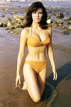 Raquel Welch 24x36 Poster sexy orange bikini at Amazon's Entertainment
